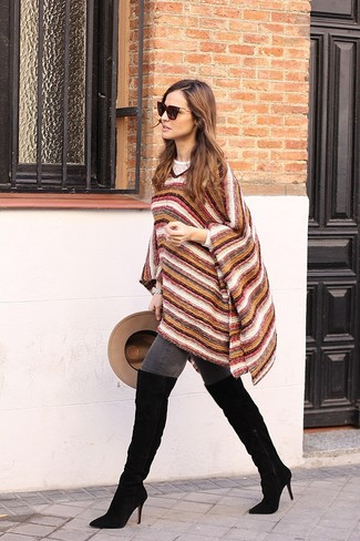 Try pairing a multi colored horizontal striped poncho with charcoal skinny jeans to create an interesting and current off-duty outfit. You could perhaps get a little creative when it comes to footwear and finish with black suede over the knee boots.