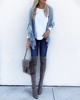 How to wear: light blue knit poncho, white long sleeve t-shirt, navy skinny jeans, charcoal suede over the knee boots