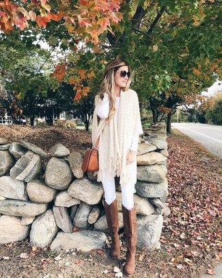 How to Wear Brown Suede Knee High Boots: A put together pairing of a beige knit poncho and white skinny jeans will set you apart instantly. A pair of brown suede knee high boots will add a classier twist to an otherwise mostly dressed-down ensemble.