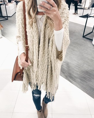 How to wear: beige knit poncho, white long sleeve t-shirt, navy ripped skinny jeans, beige suede ankle boots