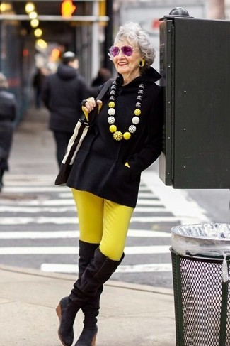 How to Wear Black Suede Over The Knee Boots: Look incredibly stylish yet casual in a black poncho and yellow skinny pants. Complete this outfit with black suede over the knee boots and the whole outfit will come together.