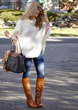 How to wear: white knit poncho, red and white horizontal striped turtleneck, blue skinny jeans, tan leather knee high boots