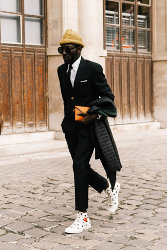 How to Wear a Black Tie For Men: This classy combination of a black puffer coat and a black tie is a must-try ensemble for any modern guy. Go ahead and add a pair of white and black print canvas high top sneakers to this ensemble for a more relaxed touch.