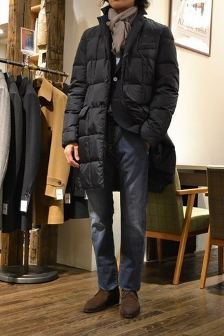 How to Wear a Black Puffer Coat For Men: One of the best ways for a man to style out a black puffer coat is to wear it with blue jeans in a casual combo. When it comes to shoes, this ensemble is finished off well with dark brown suede desert boots.
