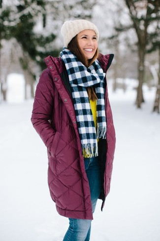 How to wear: burgundy puffer coat, yellow crew-neck sweater, blue jeans, white knit beanie