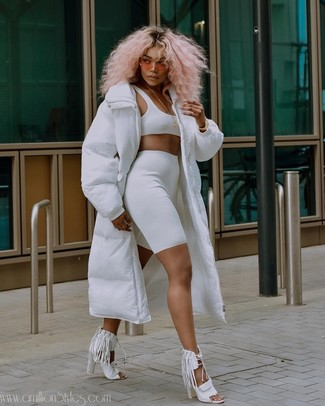 How to wear: white puffer coat, white cropped top, white bike shorts, white fringe leather heeled sandals
