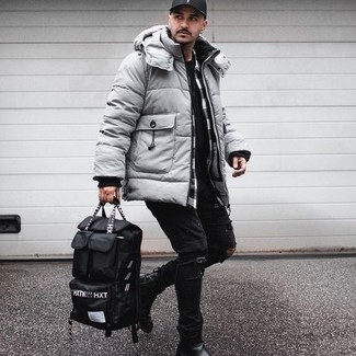 Black Canvas Backpack Outfits For Men: Pair a grey puffer coat with a black canvas backpack for an easy-to-style look. Feeling adventerous? Switch up this look by rounding off with a pair of black leather chelsea boots.