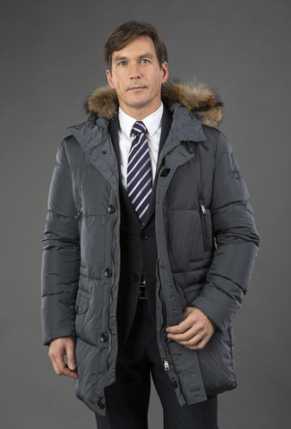 How to wear: charcoal puffer coat, black suit, white dress shirt, black and white vertical striped tie