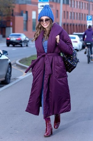 How to wear: purple puffer coat, blue sweater dress, red leather ankle boots, black print leather backpack