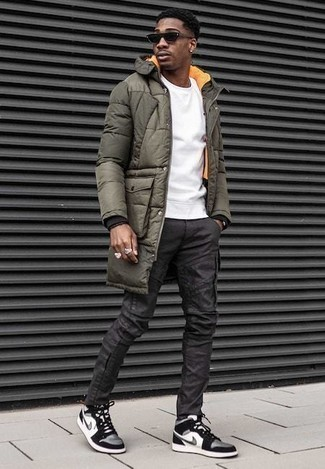 How to Wear a Coat For Men: A coat and charcoal cargo pants married together are a smart match. A trendy pair of white and black canvas high top sneakers is an easy way to power up this look.