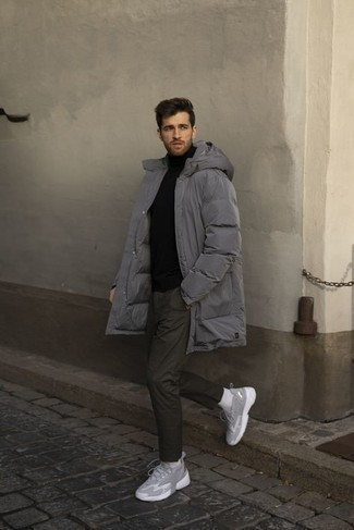 1200+ Chill Weather Outfits For Men: This pairing of a grey puffer coat and dark green chinos is indisputable proof that a safe casual outfit doesn't have to be boring. For something more on the casually cool side to round off this outfit, grab a pair of grey athletic shoes.