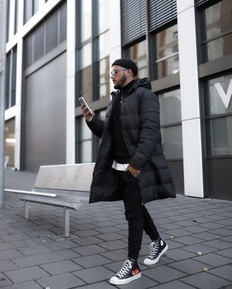 Black Puffer Coat Outfits For Men: You can look amazing without really trying in a black puffer coat and black sweatpants. To introduce a dash of stylish effortlessness to your getup, throw a pair of black print canvas high top sneakers in the mix.