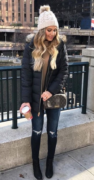 A black down coat and deep blue ripped skinny jeans will give off this very sexy and chic vibe. Elevate your getup with black suede ankle boots.