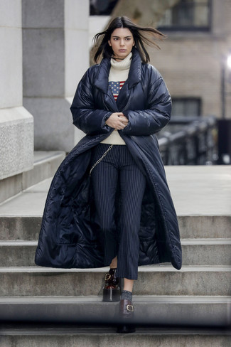 How to wear: navy puffer coat, beige print wool turtleneck, navy vertical striped wool skinny pants, burgundy leather platform loafers