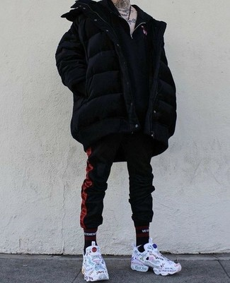 How to wear: black puffer coat, black zip neck sweater, red and black vertical striped sweatpants, white print athletic shoes