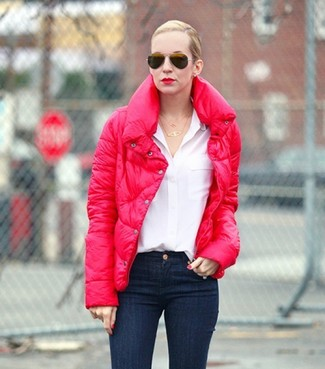 How to wear: red puffer jacket, white button down blouse, navy skinny jeans, black sunglasses
