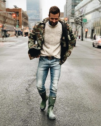 How to wear: olive camouflage puffer jacket, white cable sweater, light blue jeans, dark green rain boots