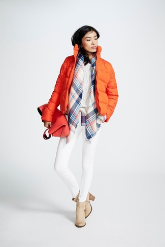 To create an outfit for lunch with friends at the weekend consider pairing an orange puffer jacket with white skinny jeans. Elevate this outfit with beige leather ankle boots. When staying inside on a crisp winter day is not a possibility, this look just might get you through the day.