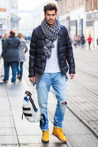 How to wear: black puffer jacket, grey cardigan, white crew-neck t-shirt, light blue ripped jeans