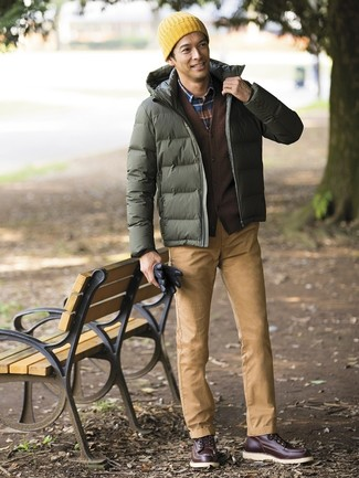 How to wear: olive puffer jacket, dark brown cardigan, navy plaid long sleeve shirt, khaki chinos