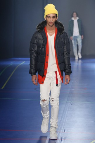 How to wear: black puffer jacket, red cardigan, white ripped skinny jeans, white low top sneakers