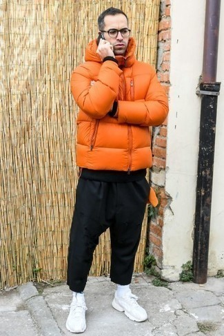 How to Wear Pants For Men: An orange puffer jacket and pants matched together are a nice match. When not sure about the footwear, stick to a pair of white athletic shoes.