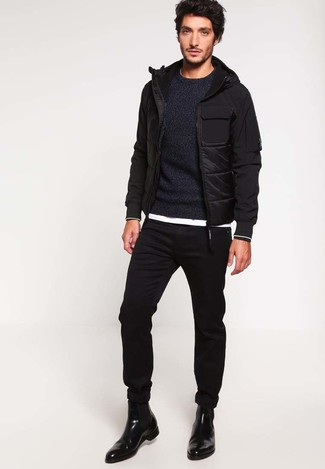 How to wear: black puffer jacket, black crew-neck sweater, white crew-neck t-shirt, black skinny jeans