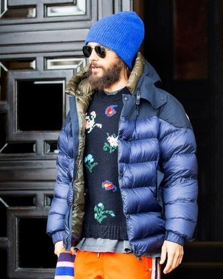 How to wear: blue puffer jacket, navy floral crew-neck sweater, grey crew-neck t-shirt, orange sweatpants