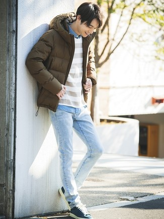 How to wear: brown puffer jacket, white horizontal striped crew-neck sweater, light blue chambray long sleeve shirt, light blue jeans