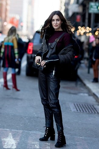 How to wear: black puffer jacket, burgundy crew-neck sweater, black leather overalls, black suede ankle boots