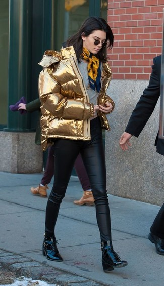 How to wear: gold puffer jacket, grey crew-neck sweater, black leather skinny pants, black leather lace-up ankle boots