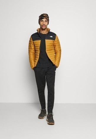 Black Crew-neck Sweater Outfits For Men: A black crew-neck sweater and black sweatpants are a combination that every style-conscious gent should have in his menswear arsenal. For something more on the daring side to complete your outfit, add dark green athletic shoes to the mix.