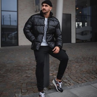 White and Black Print Crew-neck T-shirt Outfits For Men: Teaming a white and black print crew-neck t-shirt with black cargo pants is an amazing idea for a casual outfit. Get a bit experimental on the shoe front and complete this look with charcoal athletic shoes.