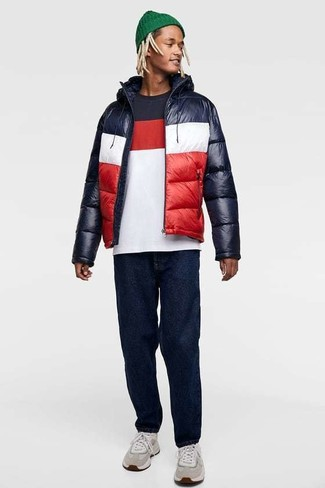 How to wear: white and red and navy puffer jacket, white and red and navy crew-neck t-shirt, navy jeans, grey athletic shoes