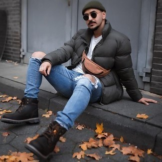 Work Boots Outfits For Men: A dark green puffer jacket and blue ripped jeans are a pairing that every dapper gentleman should have in his casual wardrobe. If you wish to instantly dress down this outfit with a pair of shoes, why not complement this ensemble with a pair of work boots?