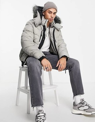 Charcoal Jeans Outfits For Men: This combo of a grey puffer jacket and charcoal jeans is truly a statement-maker. For something more on the daring side to finish off this look, introduce a pair of grey athletic shoes to the mix.