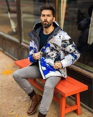 Grey Jeans Outfits For Men: A white print puffer jacket and grey jeans are a combination that every modern guy should have in his off-duty sartorial collection. To give your look a more refined finish, why not add a pair of dark brown leather casual boots to your ensemble?