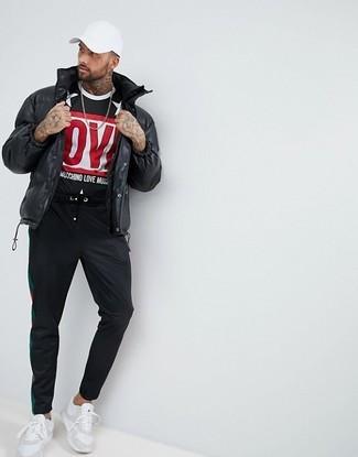 How to wear: black puffer jacket, black print crew-neck t-shirt, black sweatpants, white athletic shoes