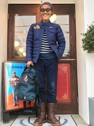 Navy Lightweight Puffer Jacket Outfits For Men: For a casual getup, try teaming a navy lightweight puffer jacket with navy sweatpants — these pieces fit nicely together. You can get a bit experimental with shoes and add brown rain boots to this getup.