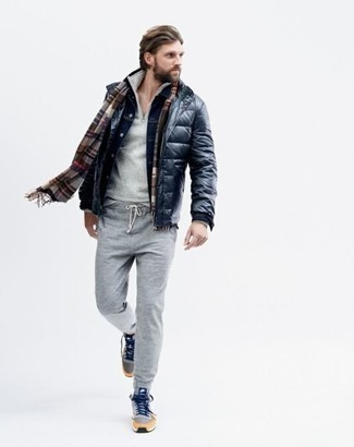 Sweatpants Outfits For Men: Marry a navy puffer jacket with sweatpants to achieve new heights in your casual fashion game. Want to tone it down on the shoe front? Complement this ensemble with light blue canvas high top sneakers for the day.