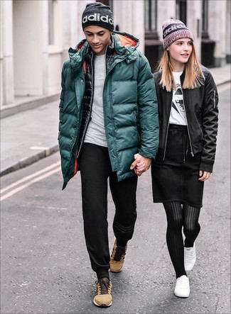Make a stylish entry anywhere you go in a teal puffer jacket and a Cole Haan Lightweight Jersey Elongated Beanie. A pair of tan low top sneakers ads edginess to a classic style. As days are getting cooler, you'll see that an outfit like this is great for the season.
