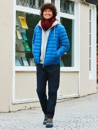 How to wear: blue puffer jacket, grey hoodie, black cargo pants, navy suede casual boots