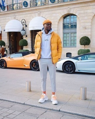 Orange Socks Outfits For Men: Such items as a mustard puffer jacket and orange socks are an easy way to introduce some cool into your daily styling repertoire. When it comes to shoes, add a pair of white athletic shoes to this look.