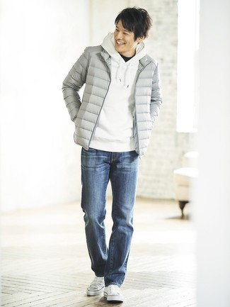 How to wear: grey puffer jacket, white hoodie, black crew-neck t-shirt, blue jeans