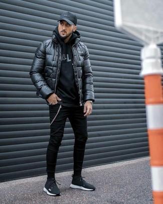How to wear: black puffer jacket, black print hoodie, black crew-neck t-shirt, black skinny jeans