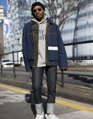 How to Wear a Navy Puffer Jacket For Men: We're loving how this classic and casual pairing of a navy puffer jacket and black jeans instantly makes any man look sharp. Feeling experimental? Dial down your ensemble by rounding off with white leather low top sneakers.
