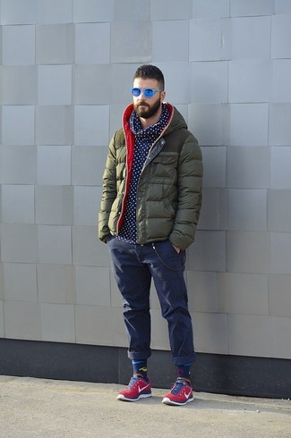 Men's Olive Puffer Jacket, Navy and White Polka Dot Hoodie, Navy Jeans, Red Low Top Sneakers