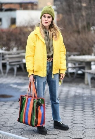 If you're obsessed with relaxed dressing when it comes to your personal style, you'll love this chic combination of a yellow padded jacket and a dark green beanie hat. Balance this outfit with black suede lace-up boots. Don't you feel all warm and comfy just from looking at this outfit? It's simply great for the winter months.