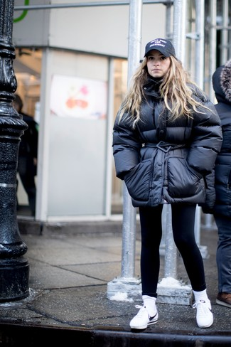 How to wear: black puffer jacket, black leggings, white leather low top sneakers, black print cap