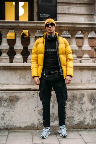 How to Wear a Black Leather Fanny Pack For Men: This combo of a yellow puffer jacket and a black leather fanny pack makes for the ultimate casual style for any gentleman. If you're clueless about how to finish off, a pair of grey athletic shoes is a winning option.